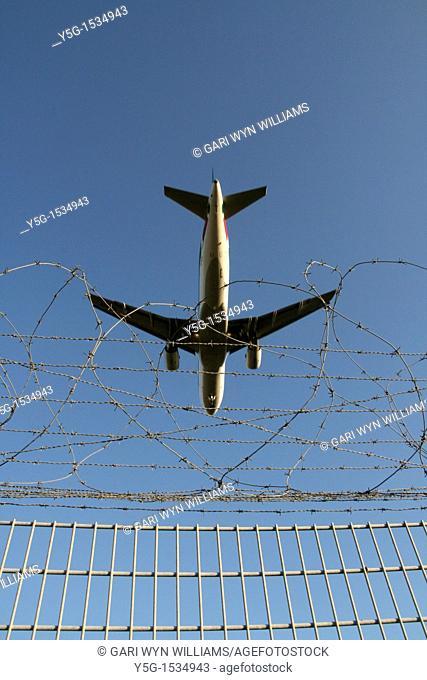 low flying plane landing at airport