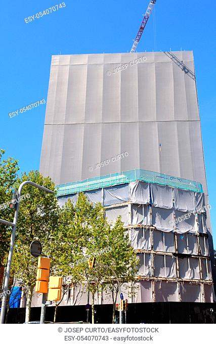 covered building under construction,