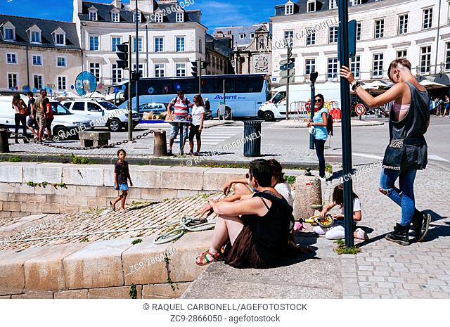 Grunge looking young people at Place Gambetta square. Vannes, Brittany, France