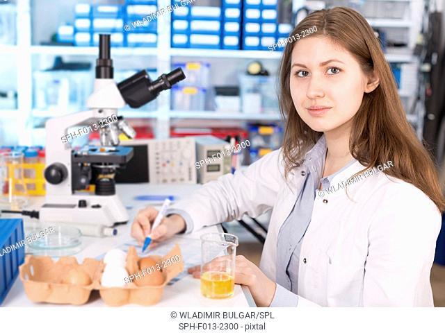 Female lab technician testing eggs in the laboratory