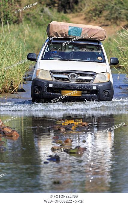 Zimbabwe, Masvingo, Gonarezhou National Park, off-road vehicle crossing Runde River