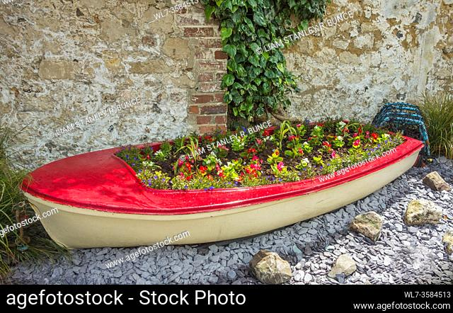 Repurposed boat turned into a flowerbed, Beer Devon UK. June 2019