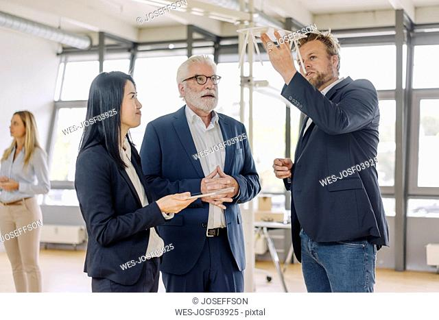 Business people having a meeting in office discussing a model