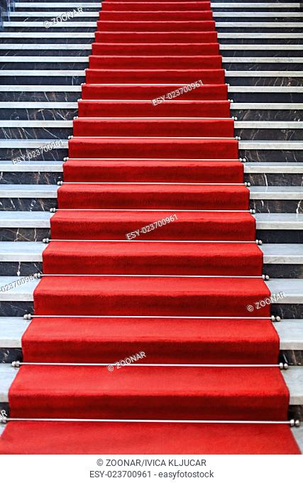 Marble Stairs covered with red carpet