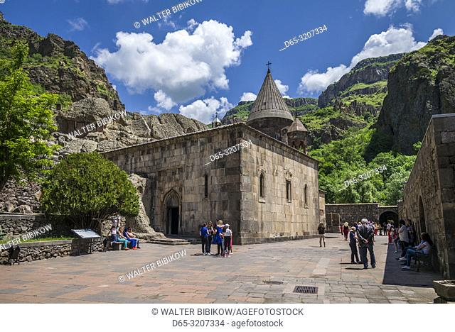 Armenia, Geghard, Geghard Monastery, Surp Astvatsatsin Church, 13th century, exterior with visitors, NR