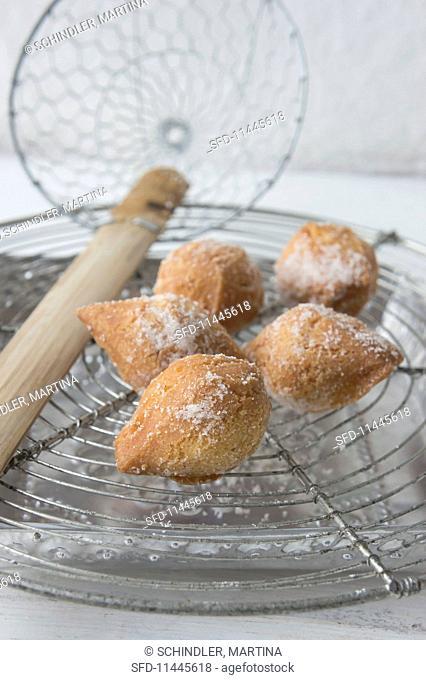 Mutzen (carvinal pastries) with powdered sugar