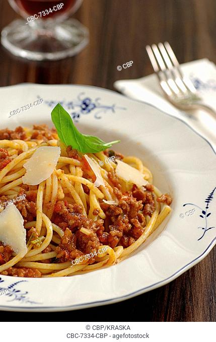 Spaghetti Bolognese, Parmesan Cheese and Basil Leaf, close-up