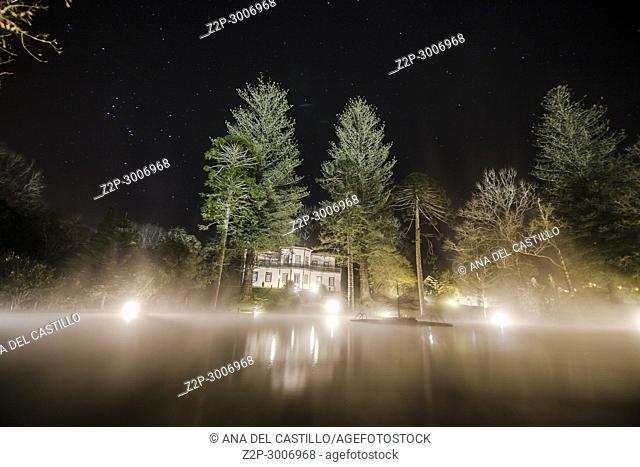 Hot spring pool in Terra Nostra park Furnas Sao Miguel island Portugal on January 2, 2018. Nightscape