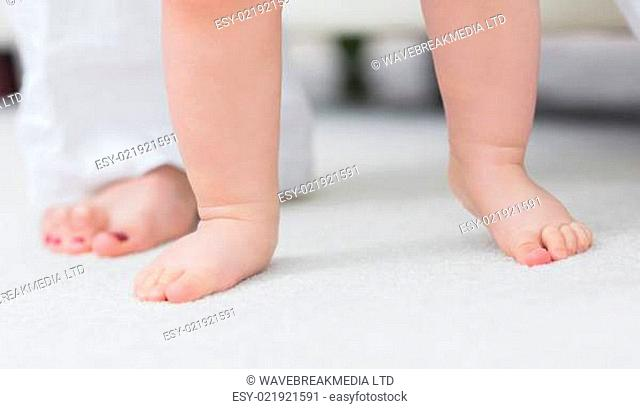 Close up of the baby feet in living room