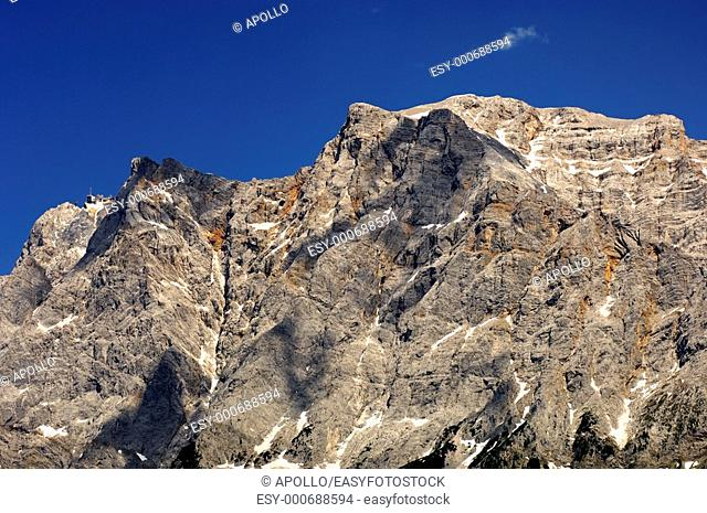 Crest of the Wetterstein mountain range with Mt  Zugspitze and the upper station of the Tyrol Zugspitze cable car, Ehrwald, Tyrol, Austria