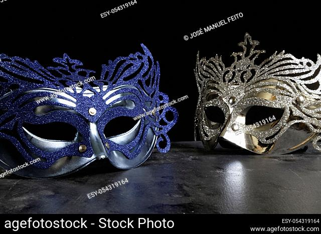 blue and silvery carnival masks on dark and black background