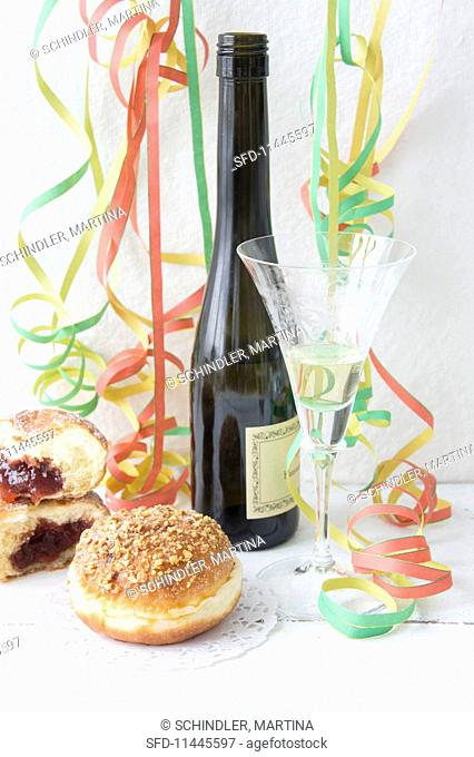 Doughnuts and sparkling wine decorated with paper streamers