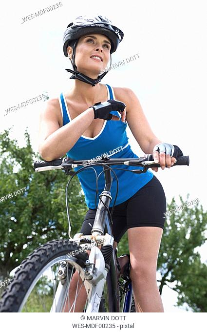 Germany, Esslingen, Woman on bicycle, portrait, close-up