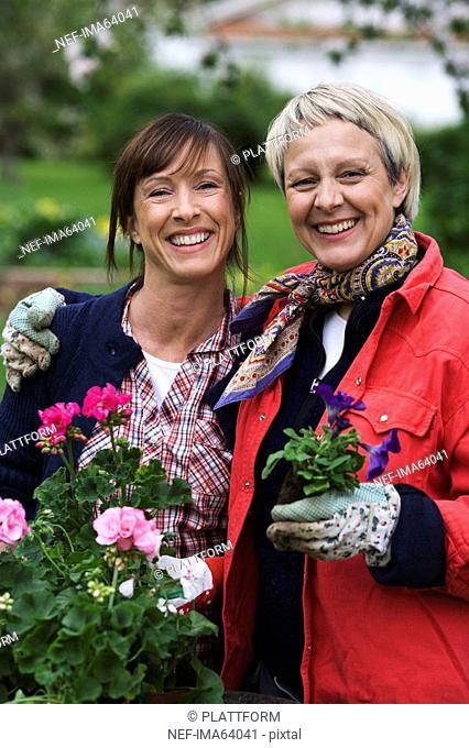 Two women setting flowers in pots Sweden