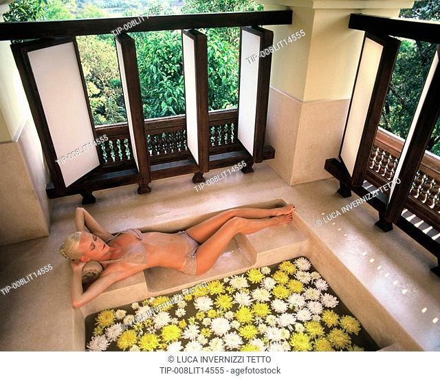 Woman at the Spa at Four Seasons Hotel in Chiang Mai, Thailand