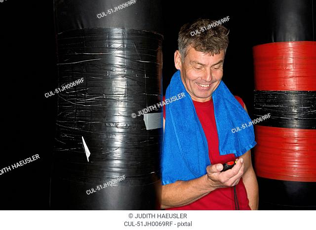 Man reading stopwatch in gym