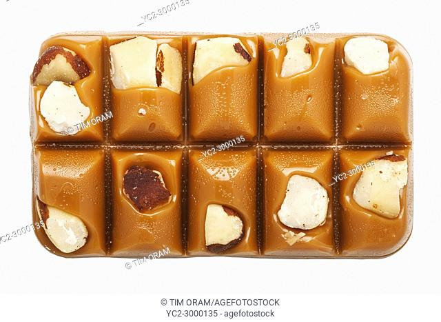 A slab of Walker's Brazil Nut Toffee on a white background