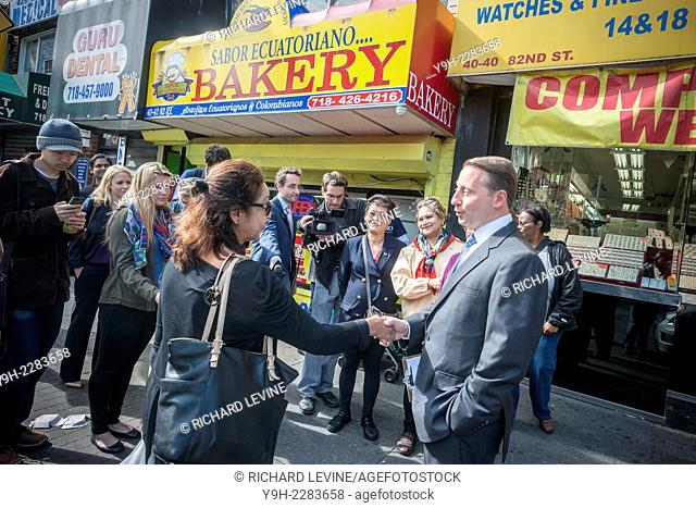 New York State Republican gubernatorial candidate Rob Astorino speaks to a voter during a meet & greet in the multiethnic community of Jackson Heights in Queens...