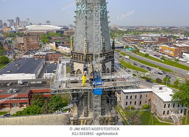 Detroit, Michigan - Steeple repair at St. Joseph Oratory Catholic Church. The steeple was damaged in a 2016 wind storm. Workers from Detroit Cornice and Slate...