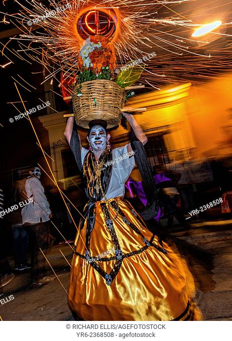 Costumed dancers with fireworks at a Comparsa, or parade during the Day of the Dead Festival known in spanish as D'a de Muertos on October 31, 2014 in Oaxaca