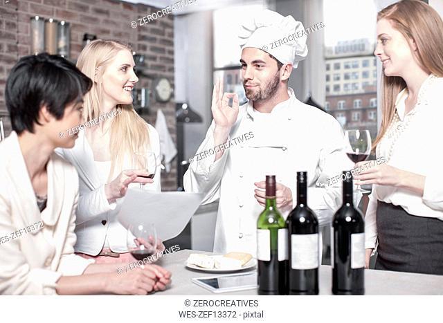 Chef with three women in kitchen