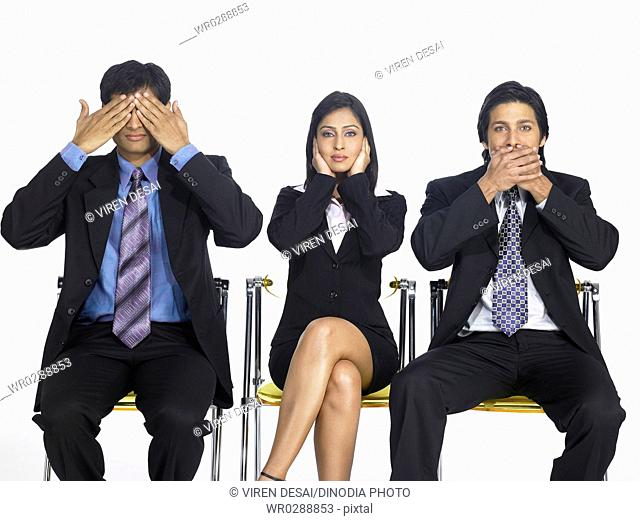 South Asian Indian executive men and woman covering eyes ears and mouth MR