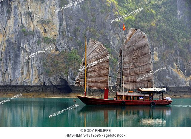 Vietnam, Quang Ninh Province, Halong Bay listed as World Heritage by UNESCO, junk boat in the bay