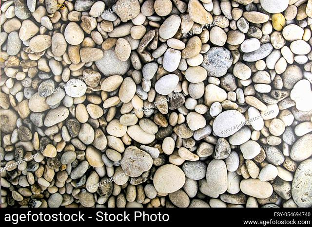 Sea stones background. Top views close-up. Nice background