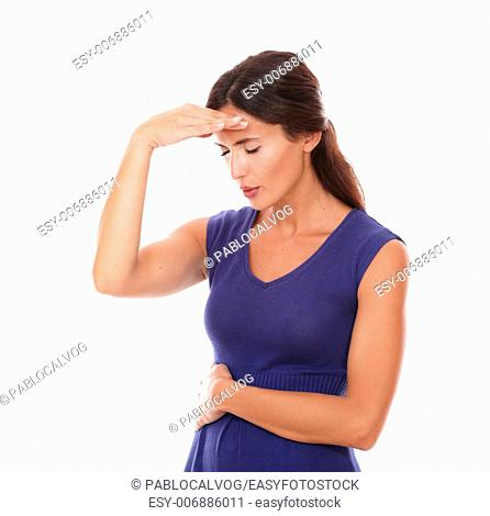 Lovely lady with hand on head and closed eyes and looking sick with headache in white background