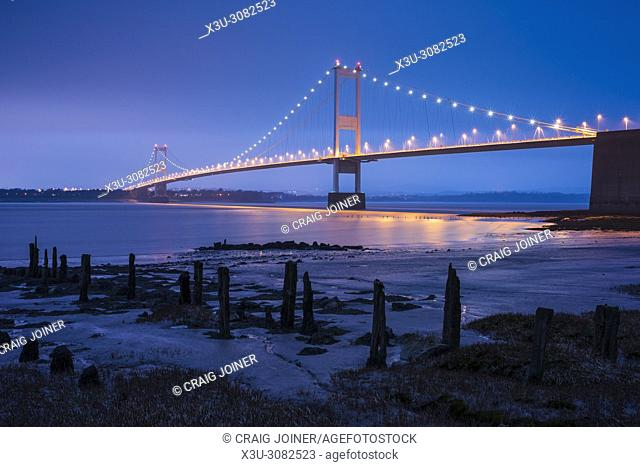 The Severn Bridge over the River Severn between England and Wales from the beach at Aust, Gloucestershire