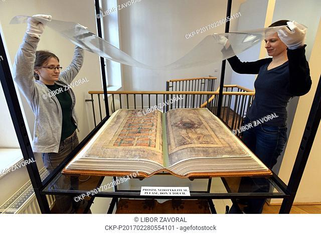 Librarians Martina Vodakova, left, and Ludmila Netusilova adjust facsimile of the Devil's Bible (Codex Gigas) exhibited Municipal Museum of Usti nad Labem