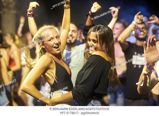 party girls dancing at music festival Starbeach Chersonissos, Crete, Greece