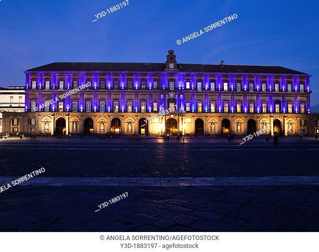 Royal palace of Naples, illuminated at night, Bay of Naples, Italy