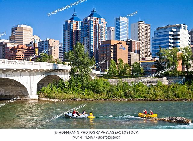 Rafting on the Bow River with the skyline in the background in Calgary, Alberta, Canada