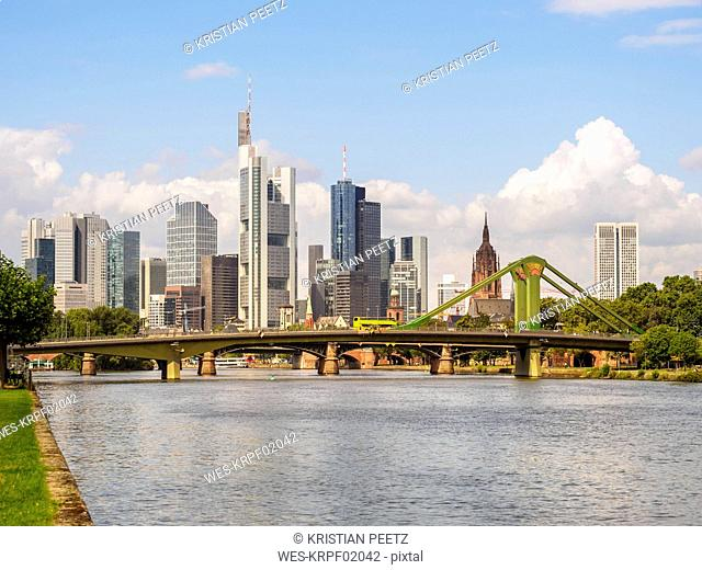 Germany, Frankfurt, view to skyline with Floesserbruecke and Main River in the foreground