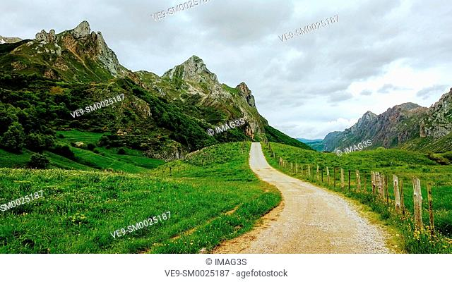 Track and mountains in Valle del Lago, Somiedo Nature Park, Asturias, Spain