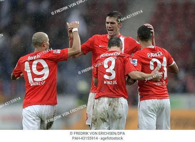 Mainz' Elkin Soto (L-R), Zdenek Pospech, Stefan Bell and Shawn Parker cheer after the Bundesliga football match between FSV Mainz 05 and 1899 Hoffenheim in...