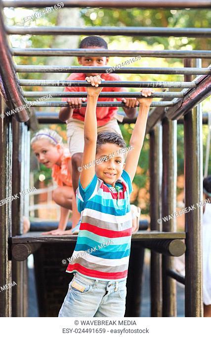 Schoolboy hanging on monkey rack