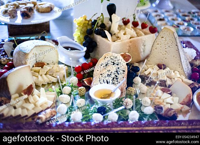 Table full of cheese for appetizers banquet