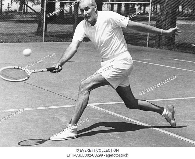 Bill Tilden, former Tennis Champion, at 58 years at Lakewood Park, Ohio. June 1951. He was practicing for the Pro Tennis Tournament, with Mayor A. I