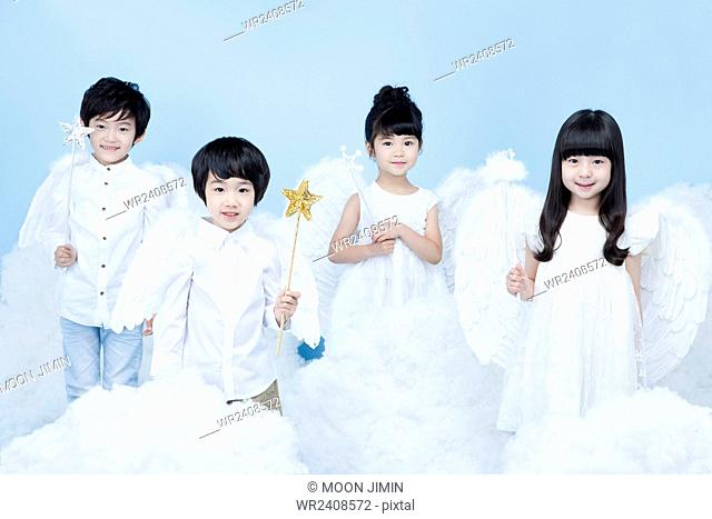 Four children in angel costume in the background representing heaven