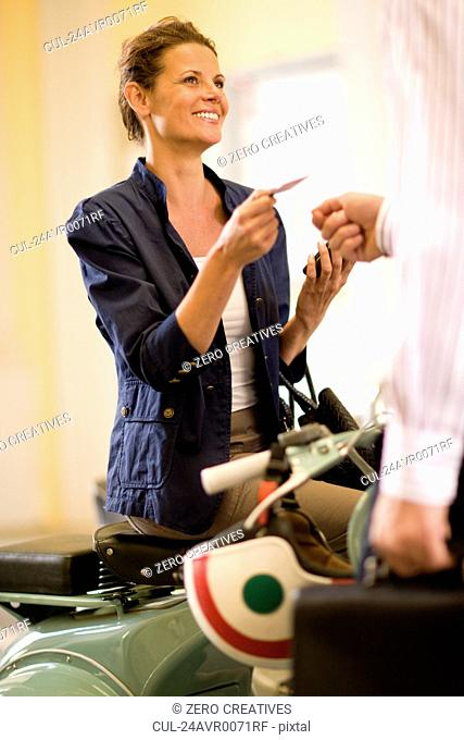 Woman reaching her credit card
