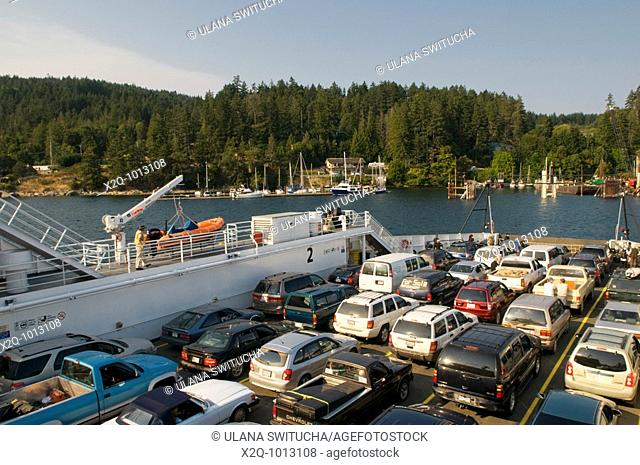 A BC Ferry approaches Fullford Harbour Saltspring Island British Columbia Canada
