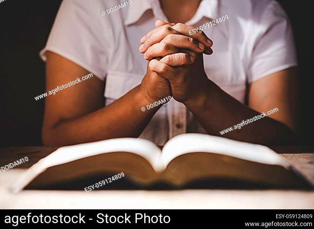 Christian life crisis prayer to god. Woman Pray for god blessing to wishing have a better life. woman hands praying to god with the bible