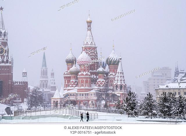Moscow Kremlin and St. Basil Cathedral on a snowfal. , Moscow, Russia