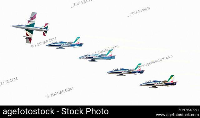 LEEUWARDEN, THE NETHERLANDS-JUNE 10, 2016: Italian aerobatic team Frecce Tricolori (Tricolor arrows) performs a show at the Dutch Airshow on June 10
