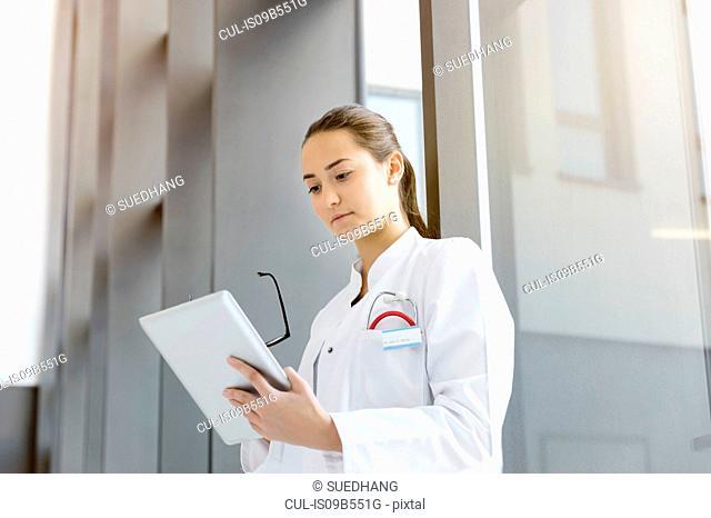 Female doctor looking at digital tablet