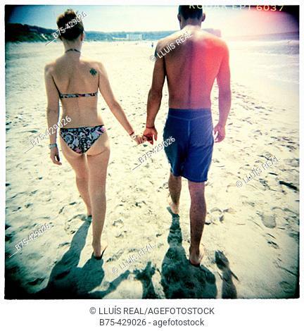 Couple in Son Bou beach. Menorca. Spain