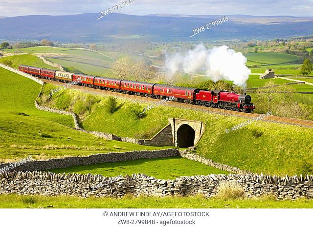 Steam train on the embankment at Greengate. Kirkby Stephen, Settle to Carlisle Railway Line, Eden Valley, Cumbria, England, United Kingdom, Europe