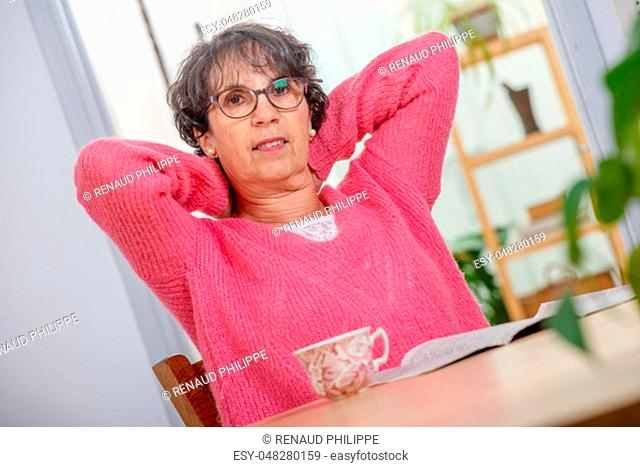 portrait of a beautiful mature woman dressed with a pink sweater